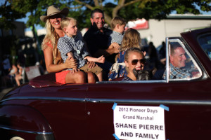 Shane Pierre and his family ride as Grand Marshal of the Bill Pierre Auto Centers Grand Parade during Lake City's 70th annual Pioneer Days. The annual festival includes a street fair, salmon bake and parade. Photographed on Saturday, August 4, 2012. (Joshua Trujillo, seattlepi.com)