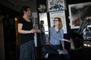 Voice teacher Lorrie Ruiz, left, works with student Heather Newton during a lesson at the Seattle Drum School in north Seattle on May 4, 2013. (seattlepi.com photo, used with permission)