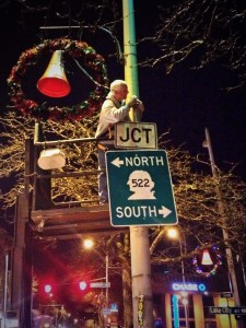Holiday decorations are put up along Lake City Way in 2013. (LCL photo)