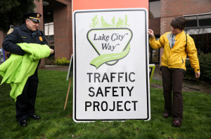 The Lake City Way Traffic Safety Project sign is unveiled. (LCL photo)