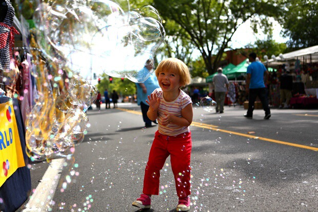 Anya enjoys bubbles at the festival
