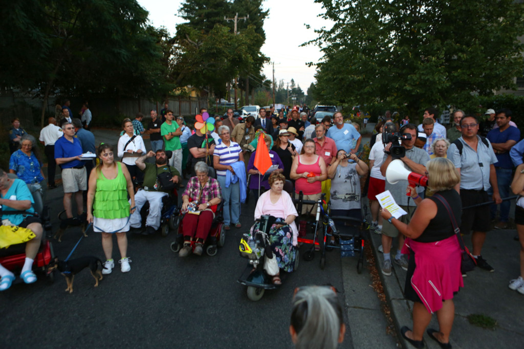 Community members gather near the intersection of 30th Avenue NE and NE 130th Street. (LCL photo)